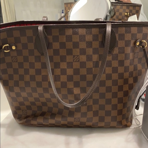 Louis Vuitton never full with pouch